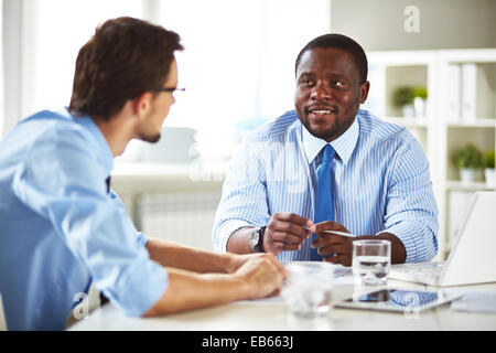 Businessman talking to a new employee - Stock Photo