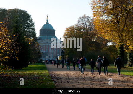 People walking through Park Sanssouci in autumn, Neues Palais palace, Potsdam - Stock Photo
