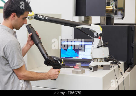 Technical inspecting production piece. MCAx measuring arm. Coordinate measuring machine portable with escanner for - Stock Photo