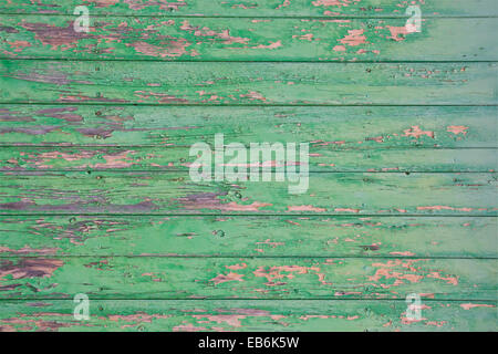 Green flaky painted surface. Green flaky painted wooden planks horizontal full frame for grungy background, real - Stock Photo