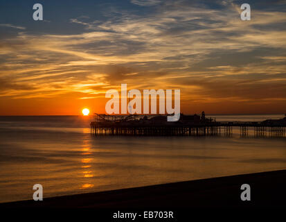 Sunset over Brighton Pier, England, UK - Stock Photo