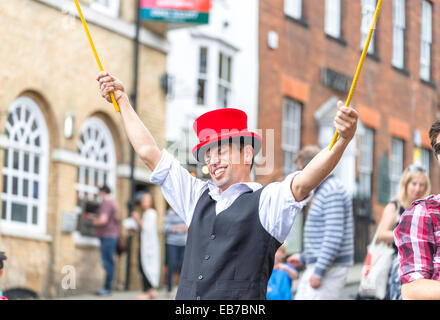 Man playing a soap bubble on high street at Arundel Festival 2014 - Stock Photo