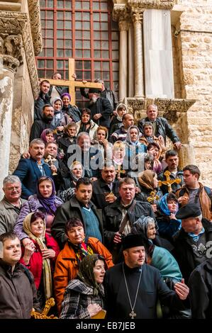 Armenian pilgrims outside the Church the Holy Sepulchre site the last five stations the Cross and venerated as the - Stock Photo