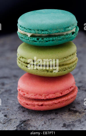 Stack of macaroons biscuits over gray stone texture - Stock Photo