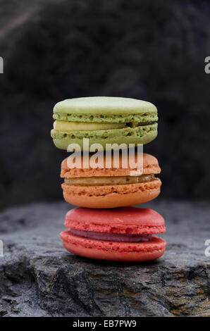 Stack of macaroons biscuits over gray stone - Stock Photo