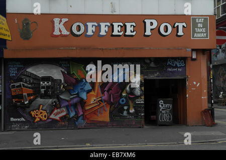 kELzO street art mural closed roller blinds Koffee Pot Cafe, Hilton Street, Stevenson Square, Northern Quarter, - Stock Photo
