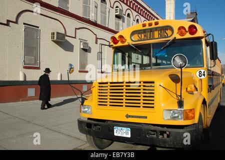 New York City, school bus in Crown Heights Jewish neighborhood, Brooklyn - Stock Photo