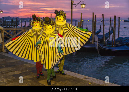 Three masked women at the carnival in Venice, Italy, Europe - Stock Photo