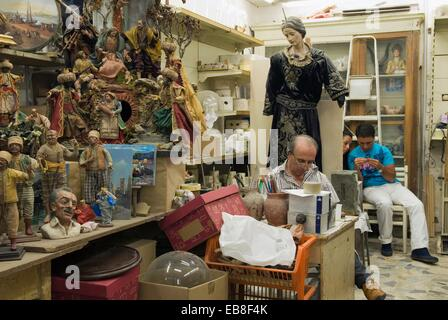 santons workshop in San Gregorio Armeno street, Naples, Campania region, southern Italy, Europe - Stock Photo