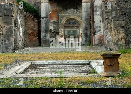 Ruins of the nymphaeum or monumental fountain in an ...