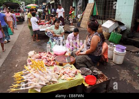 Burma women Selling chicken at Local Market, yangon, myanmar - Stock Photo