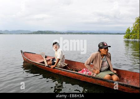 amerindian family fishing in Isla Bastimentos National Marine Park Bocas del Toro Archipelago Republic of Panama - Stock Photo
