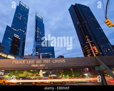 Police line do not cross At right Trump International Hotel and Tower at left Time Warner Center Columbus Circle - Stock Photo