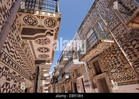Xysta on the houses Pygri geometic patterned decorations in black and white that adorn the houses the Mastic Villages - Stock Photo
