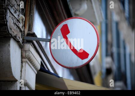 Public phone sign in Venice,Italy,Europe - Stock Photo