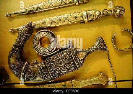 Traditional Arab dagger or khanjar, Souvenir carpet and jewelry antique shop, Jordan, Middle East. - Stock Photo