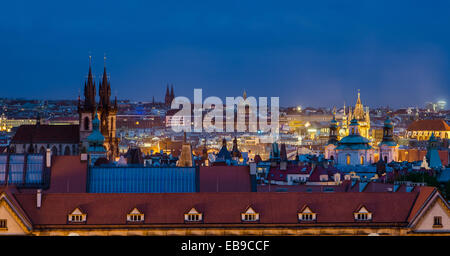 An overhead view of Old Town, Prague, with spires and rooftops, in the evening. - Stock Photo