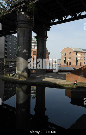 Blue sky portrait tubular steel 1894 Great Northern Viaduct reflecting in and crossing Castlefield Canal Basin, - Stock Photo