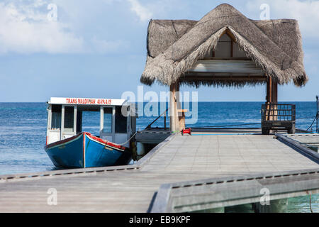 A traditional Maldivian Dhoni used to transfer passengers between an island resort and a seaplane - Stock Photo