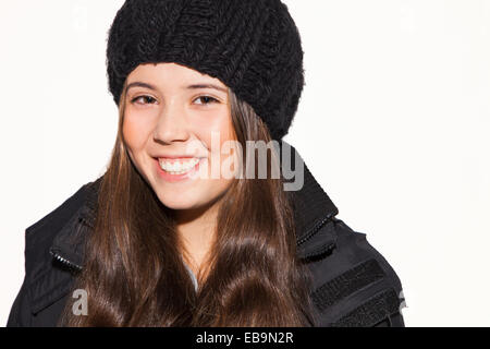 Teenage Girl Wearing Wool Hat Smiling - Stock Photo