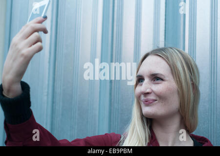 Woman Taking Selfie with Smartphone - Stock Photo