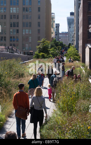 People walking along the High Line, New York City, USA - Stock Photo