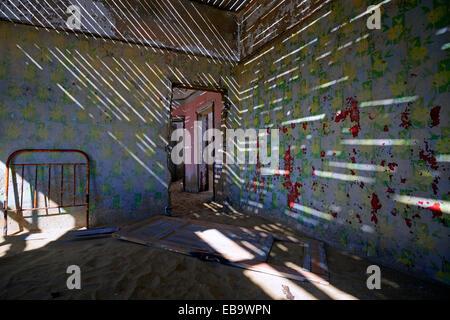 Abandoned building in the former diamond mining town, now a ghost town, Kolmanskop, Lüderitz, Karas Region, Namibia - Stock Photo