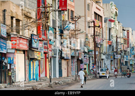 Storefront with billboards, street in city centre, Madurai, Tamil Nadu, India - Stock Photo