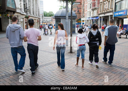 Group of teenagers walking down the street together, - Stock Photo