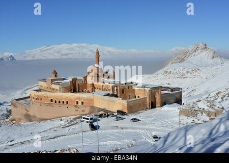 Ishak Pasha castle (Turkey) is situated against the white mountains background. - Stock Photo