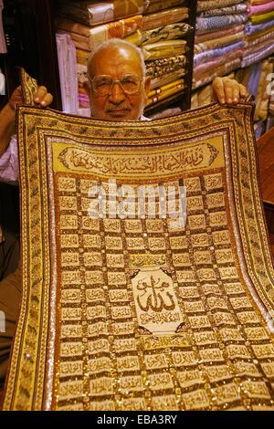 Carpet with the 99 names of God in the souk, Homs, Syria - Stock Photo