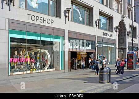 Early morning view of Topshop and Topman stores in Oxford Street West End London England UK - Stock Photo