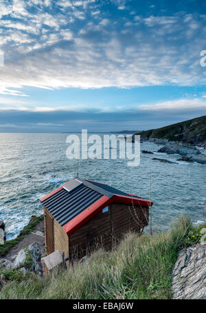 Wooden hut on cliffs at freathy on whitsand Bay in Cornwall - Stock Photo