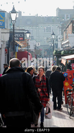 Shoppers crowd into the bohemian North Laine district of Brighton today on the look out for Christmas bargains on - Stock Photo