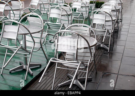 Aluminium chairs and tables outside a cafe - Stock Photo