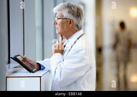 Doctor with tablet in corridor, Onkologikoa Hospital, Oncology Institute, Case Center for prevention, diagnosis - Stock Photo