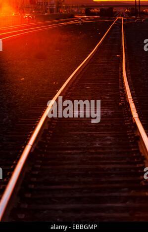 Train tracks at sunset, Gallup, New Mexico USA - Stock Photo