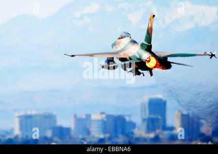 An F-16 Aggressor takes off March 3, 2010, during a Red Flag Exercise at Nellis Air Force Base, Nev  Red Flag is - Stock Photo