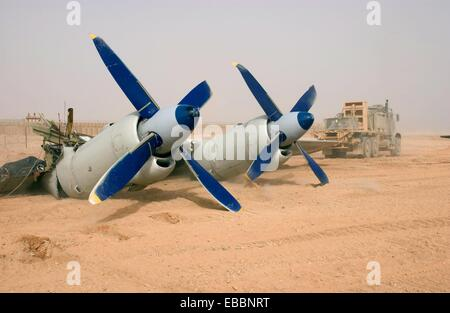 100728-N-0000M-010 HELMAND PROVINCE, Afghanistan July 28, 2010 The engines of a cargo plane protrude from the ground - Stock Photo
