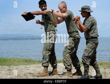PUERTO BARRIOS, Guatemala Sept  9, 2010 During mixed martial arts training, 2nd Lt  Matthew Ludlow, center, assigned - Stock Photo