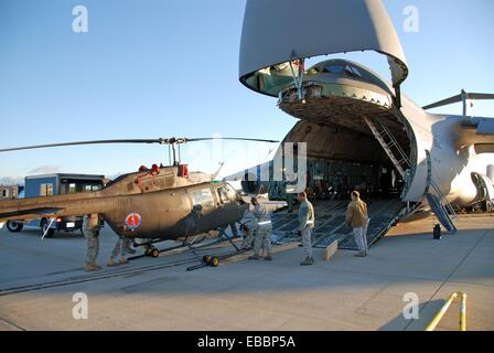 New York Army National Guard Soldier unload an OH-58 Kiowa Sept 17, 2010, at Cape Town International Airport, South - Stock Photo