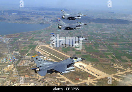 A formation of F-16 Fighting Falcons from the 8th Fighter Wing at Kunsan Air Base, South Korea, fly in close formation - Stock Photo