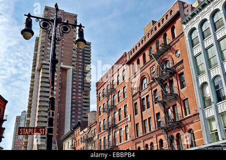 Street Sign, Staple Street, Intersection with Duane Street, Cast Iron Loft Buildings in the Background, Tribeca - Stock Photo