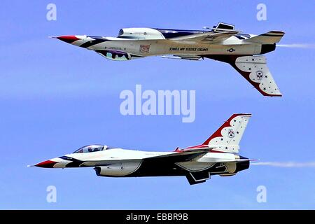 The Air Force Thunderbirds Aerial Demonstration Squadron performs an air show for a crowd of about 25,000 people - Stock Photo