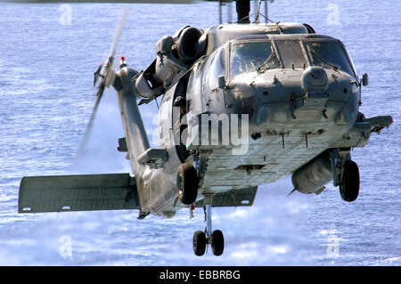 SOUTH CHINA SEA (Apr. 5, 2007) - An HH-60H Seahawk from the ´Black Knights´ of Helicopter Anti-Submarine Squadron - Stock Photo