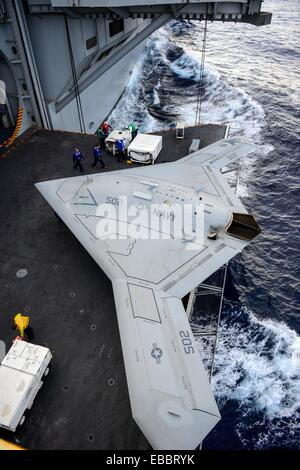 ATLANTIC OCEAN Dec  11, 2012 An X-47B Unmanned Combat Air System UCAS demonstrator aircraft is transported on an - Stock Photo