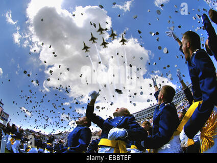 U.S. Air Force Academy graduates throw their hats in the air May 30 as the Air Force Thunderbirds fly overhead signaling - Stock Photo