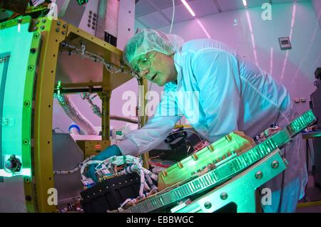 Martin Leahy performs voltage and continuity tests on a tactical satellite, or TacSat-3, at the Air Force Research - Stock Photo