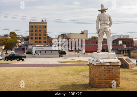 The old cowboy looks down from Boot Hill onto Dodge City, Kansas. - Stock Photo