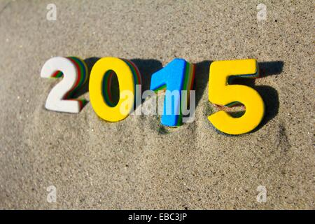 the year 2015 in numbers on a sand background - Stock Photo